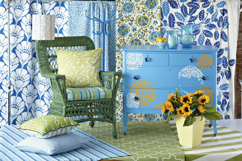 A fresh coat of paint gives a completely new look to a wicker chair, coat tree and dresser, above. Rub-on decals and pansy-shaped ceramic knobs add nifty touches to the dresser.