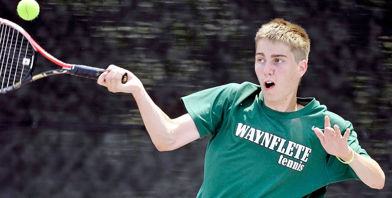 Eric Ordway of Waynflete hits a forehand in his match against Spencer Shagoury of Hall-Dale. Ordway helped the Flyers clinch their fourth straight boys' regional title.