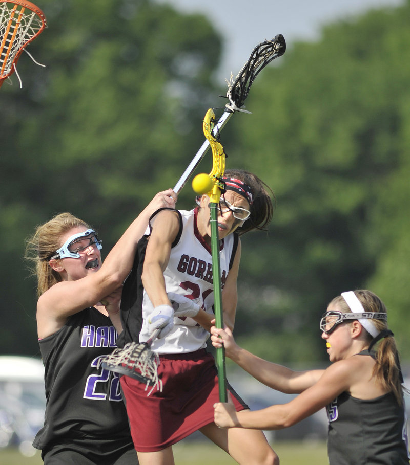 Mia Rapolla, center, of Gorham drew plenty of attention from Marshwood defenders Wednesday in a Western Class A girls lacrosse quarterfinal, but that didn't stop her from getting 10 goals in a 17-5 win.