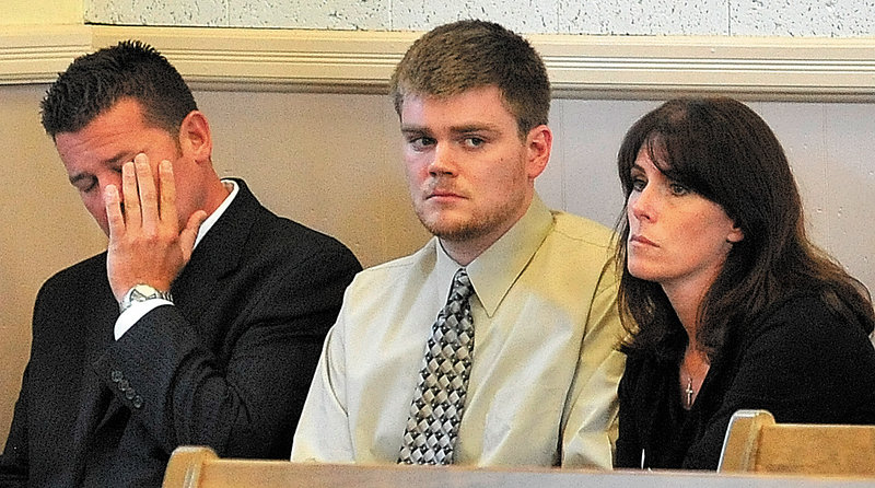 Ryan Ouimet sits with his parents, Robert and Michele Ouimet, during his first court appearance on a manslaughter charge in Franklin Superior Court on Wednesday.
