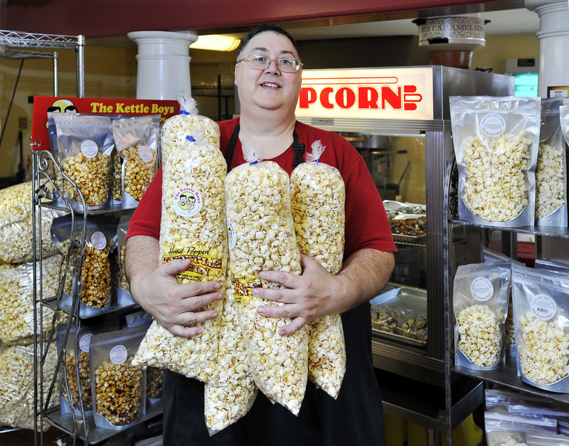 Surrounded by many of his large variety of popcorn products is Jeremy Prescott of Kettle Boys Popcorn in York Beach. The company makes about 25 different flavors of popcorn, including Cha Cha Cheddar, but kettle corn is its best-selling staple.