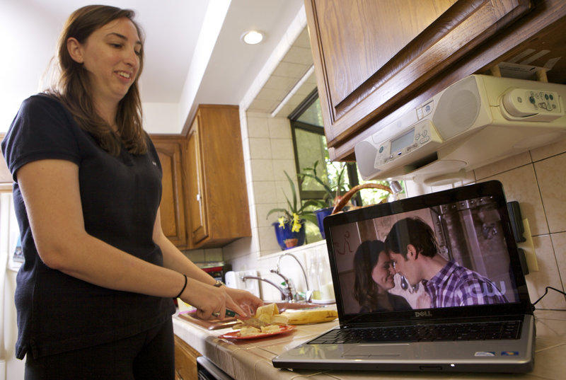 "Kate Hooper, a 24-year-old nanny, is willing to ""put up with"" more ads as she watches streamed TV on her laptop at work."