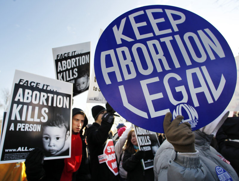 Abortion opponents and abortion-rights supporters make their views known in front of the U.S. Supreme Court building last January on the anniversary of the court's 1973 Roe v. Wade decision on abortion rights.