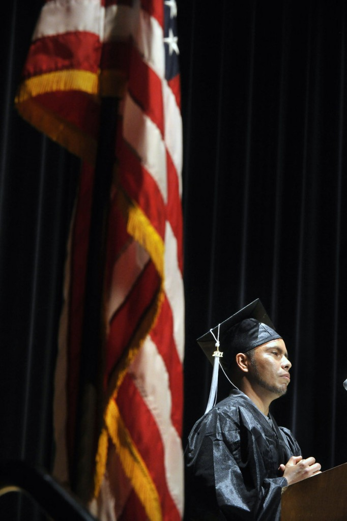 PAE graduate Selvin Arevalo shares his story about his efforts to remain in this country to receive an education despite being an undocumented immigrant during Thursday's ceremony.