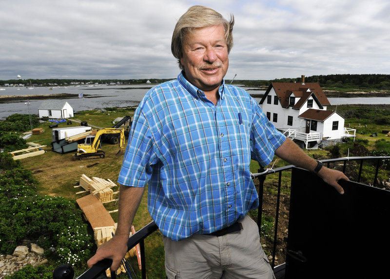 Scott Dombrowski stands atop the lighthouse on Goat Island, where he has been caretaker for 19 years. After the station renovation is completed in September, a $2 million endowment will be created to preserve the site for future generations.