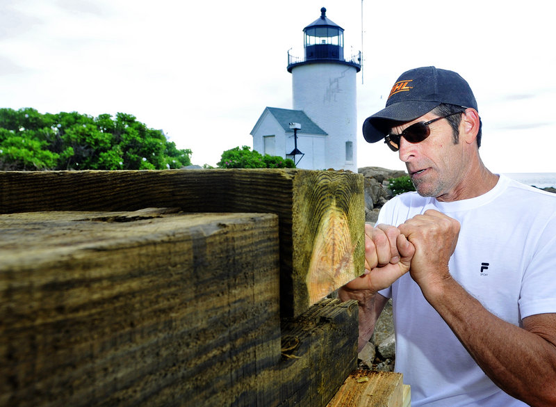 Alan Bartlett, a contractor from Kennebunkport, builds the base Friday for a new bell tower at the Goat Island Light Station off Cape Porpoise. The previous tower was torn down in the 1960s.
