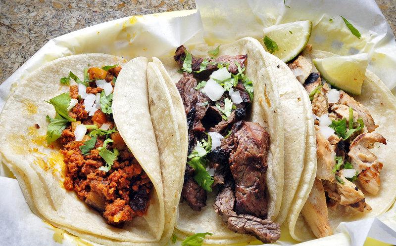 The chorizo, carne asada and pollo asada tacos at Taco Trio on Ocean Street in South Portland.