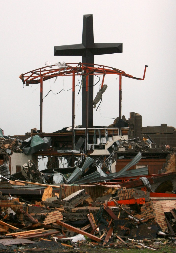 A cross rises above the rubble of St. Mary's Catholic Church in Joplin, Mo., on May 23 after a tornado devastated the town. A majority of white evangelicals – 59 percent – say natural disasters are a sign from God.