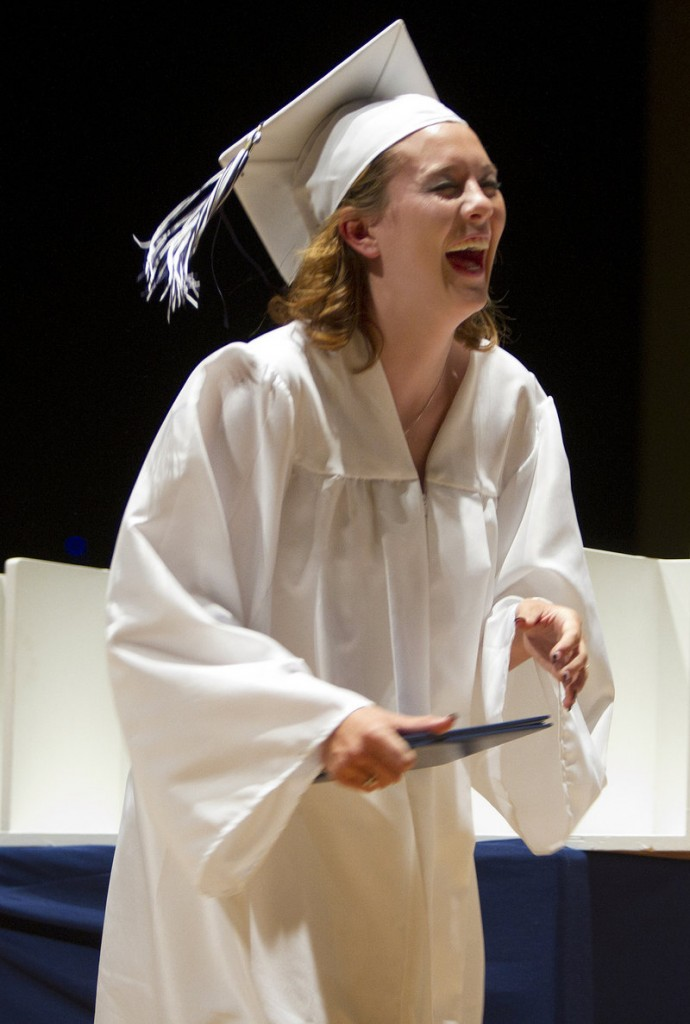 Westbrook High graduate Katelyn Benson laughs after her diploma was dropped during its presentation.