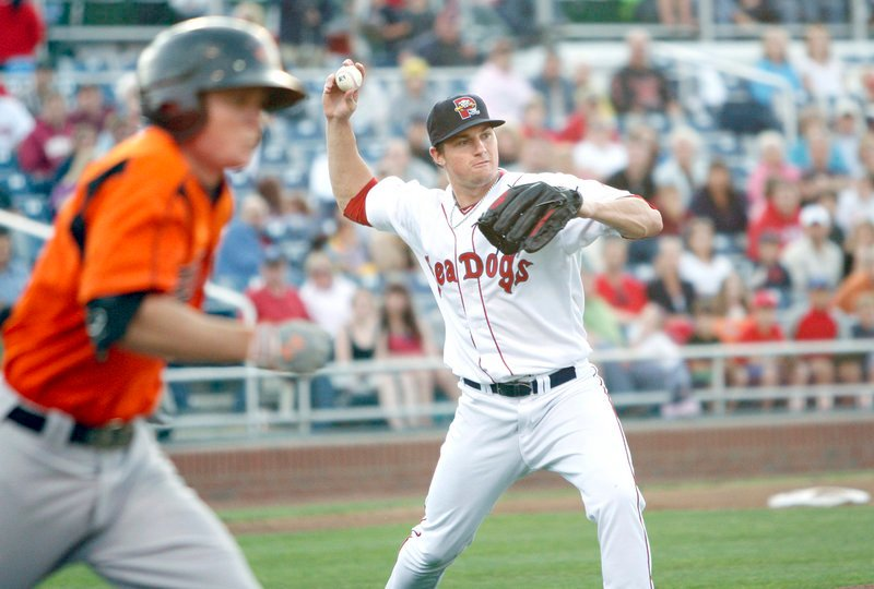 Sea Dogs starter Chris Balcom-Miller throws to first base for an out after fielding a ground ball Friday night during a game against the Bowie Baysox at Hadlock Field. Bowie scored six runs in the first inning and won, 7-3.