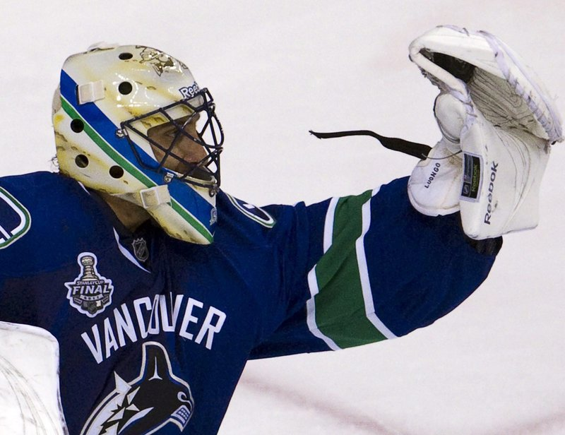 Roberto Luongo of the Canucks makes a glove save, one of 31 stops he made to shut out the Bruins 1-0 Friday night in Game 5 of the Stanley Cup finals.