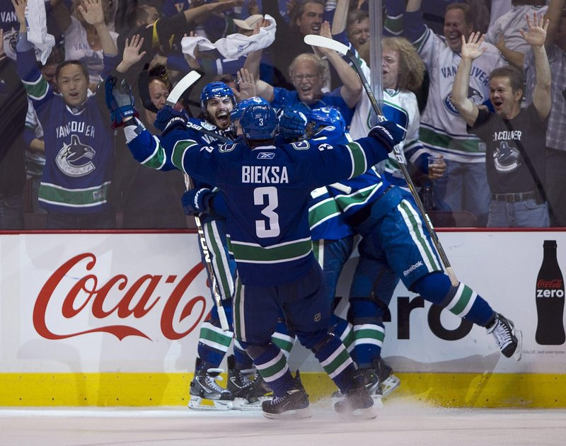 Maxim Lapierre is the center of attention after scoring with 15:25 to play in the third period, the only goal Vancouver needed Friday night to beat the Bruins for a 3-2 series lead.