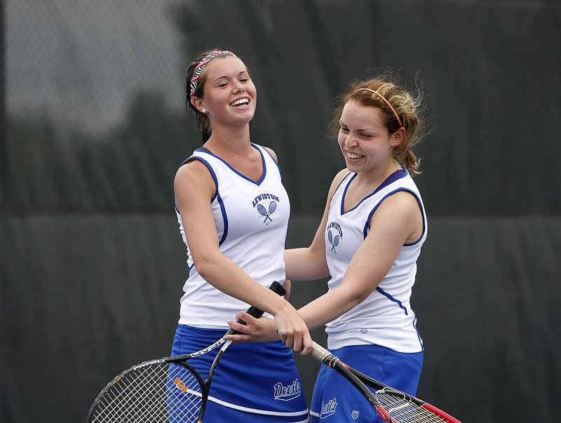 Lewiston had many reasons to celebrate on Saturday with a sweep of the Class A state tennis titles at Colby College in Waterville. Kirsty Beauchesne, left, and Brittany Martin did their part with a win at No. 1 doubles.