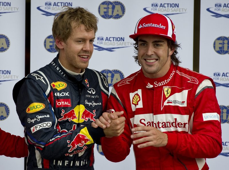 Sebastian Vettel, left, of Germany, is congratulated by the second-place qualifier, Ferrari's Fernando Alonso of Spain, after taking the pole position for today's Canadian Grand Prix in Montreal.