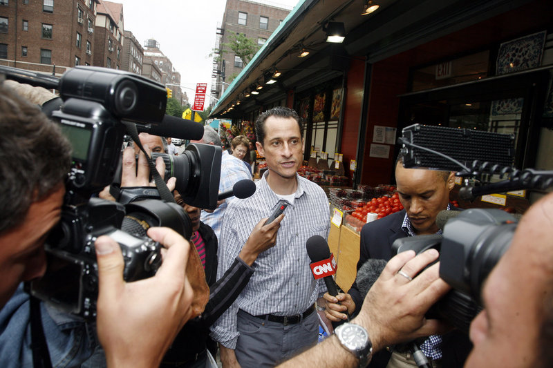 Rep. Anthony Weiner, D-N.Y., is questioned by the media near his home in Queens on Saturday. Party leaders called on him to resign for his role in a sex texting scandal.
