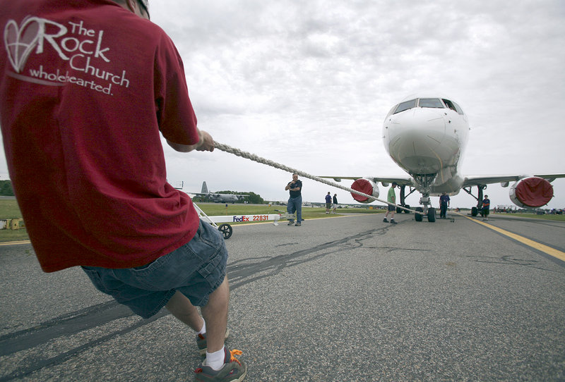"A competitor pulls a Boeing 757 in the Multiple Sclerosis Society of Maine ""Plane Pull"" event during the expo Saturday."