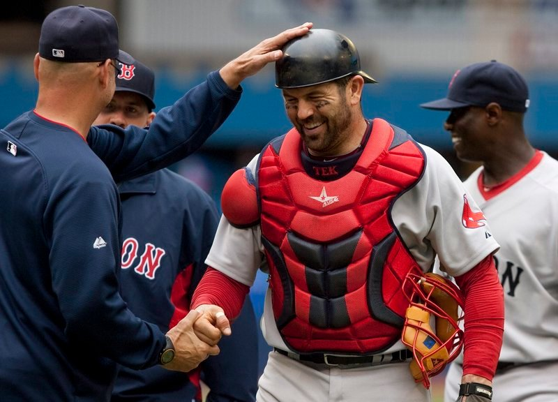 Jason Varitek laughs with Manager Terry Francona following Boston's 16-4 win over Toronto on Saturday. Varitek had a three-run home run as every Boston starter drove in at least one run.