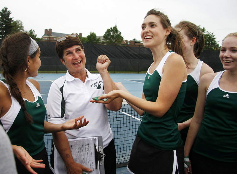Waynflete Coach Linda Cohen, second from left, celebrates with team members, from left, Elena Britos, Maddie High, Hilary Niles and Emily White after winning the Class C state title Saturday at Colby College in Waterville.