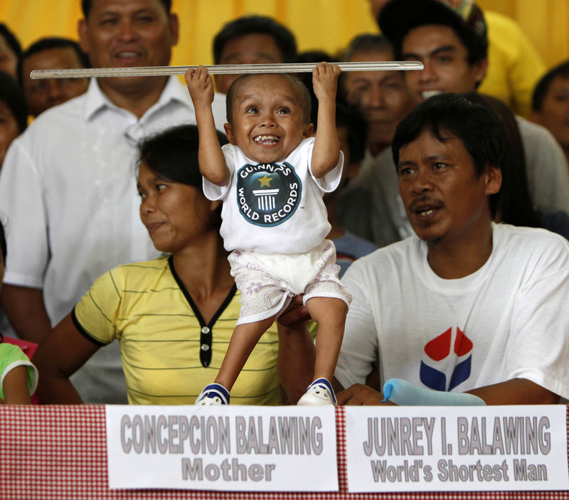 Junrey Balawing jokes around with a ruler before he was measured by the Guinness World Records in Sindangan township, Zamboanga del Norte province, in the southern Philippines on Sunday, his 18th birthday and coincidentally the Philippines' Independence Day.