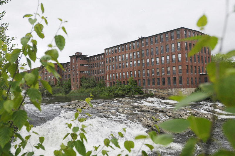 The Dana Warp Mill's location overlooking the Presumpscot River in Westbrook has helped attract tenants. But some business owners leasing space hope the new owner will make improvements, including an upgrade of the freight elevator and adding parking spaces.