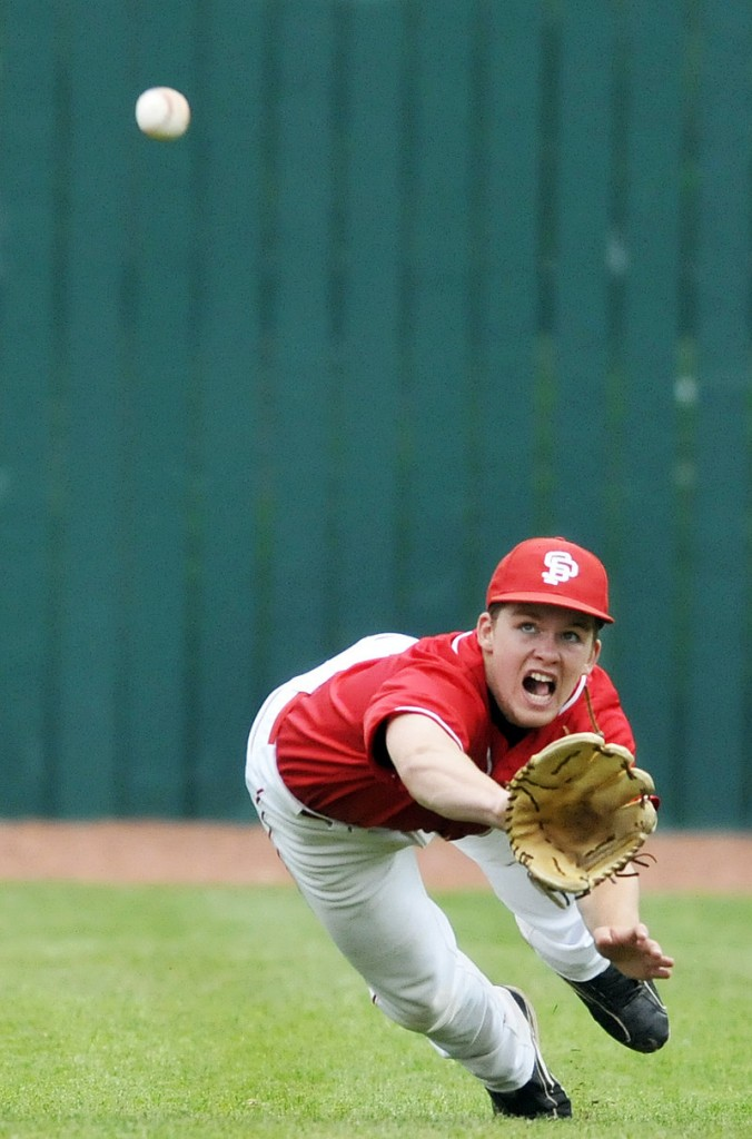 South Portland's Jack Bushey dives for the ball but can't quite make the catch at The Ballpark on Monday in Old Orchard Beach. Cheverus doused South Portland's 2-0 lead with a big fourth inning.