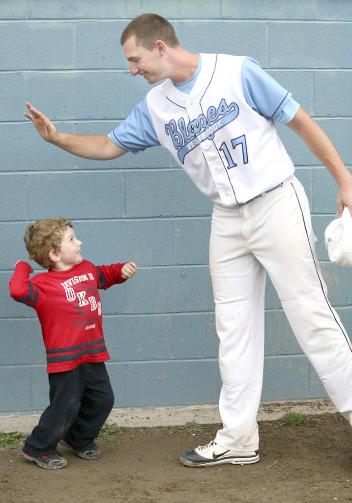 Cam Gardiner, 3, high-fives his uncle, Zach Gardiner, after Westbrook defeated Marshwood 2-1 in a Western Class A baseball semifinal Monday in Westbrook.