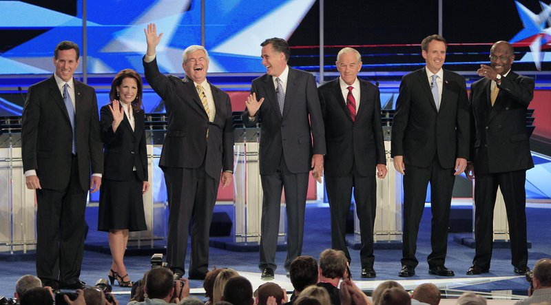 From left, former Pennsylvania Sen. Rick Santorum, Rep. Michele Bachmann, R-Minn., former House Speaker Newt Gingrich, former Massachusetts Gov. Mitt Romney, Rep. Ron Paul, R-Texas, former Minnesota Gov. Tim Pawlenty and businessman Herman Cain stand on stage before the first New Hampshire Republican presidential debate at St. Anselm College in Manchester, N.H., on Monday night.