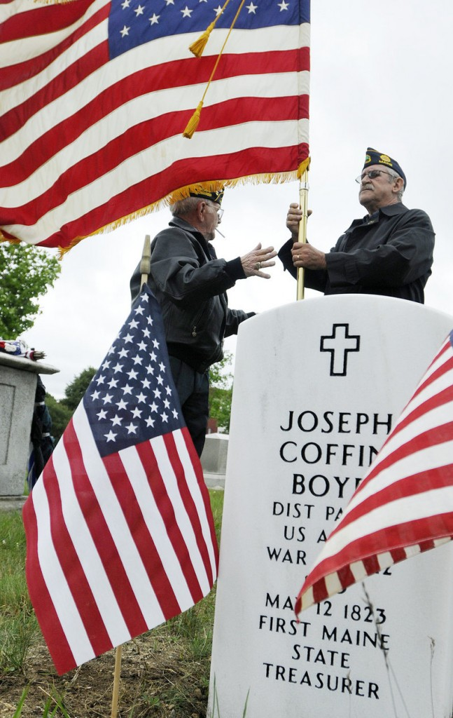 American Legion Post 17's Bob Wright, left, and Bill Chittick participate in the dedication ceremony Tuesday.