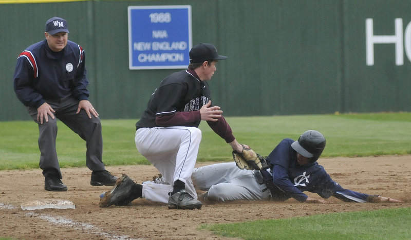 Third baseman Liam Maker of Greely tags out Davis Brown of Yarmouth, who was attempting to advance to third on a single Tuesday during Greely's 8-6 victory in the Western Class B final at St. Joseph's College.