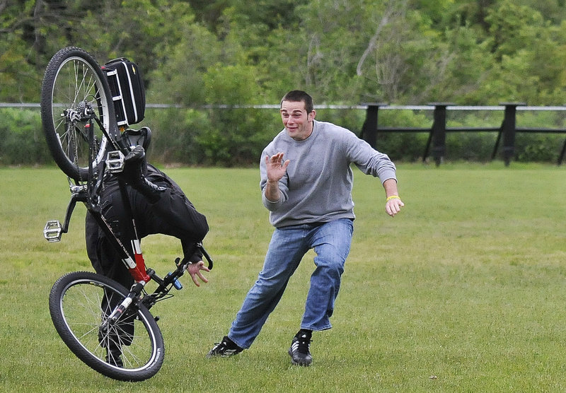 Brian Trefethen, an Ogunquit Police Department reserve officer, dodges the Kennebunk Police Department's Andrew Bridges, on the bike, during a drill Tuesday at York Middle School.