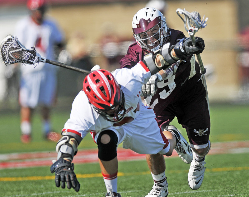 Luke Erwin of Scarborough is checked by Thornton's Daniel Giroux during the Western Class A lacrosse final Wednesday at Scarborough. The Red Storm advanced to meet Lewiston in the state final Saturday.