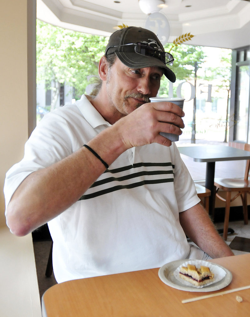 Pete Land, a former coworker of Ed Foley's, enjoys coffee and pastry at his friend's establishment.