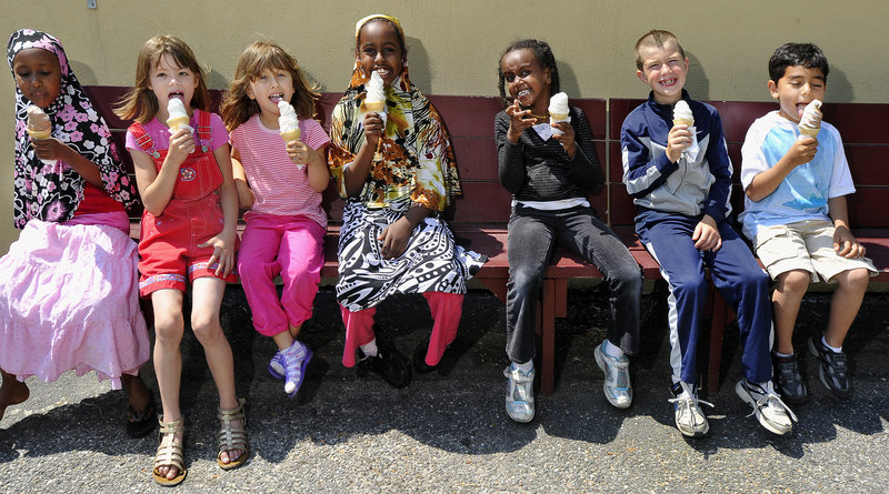 First-graders in Rebecca Maiorano's class at Presumpscot Elementary School in Portland celebrate by walking to Beals Ice Cream. From left: Nasteho Isacks, Metallissa McCorrison, Cassidy Darling, Muna Omar, Sabrina Dhubow, Ivan Blazevic and Rustam Ahmadov.