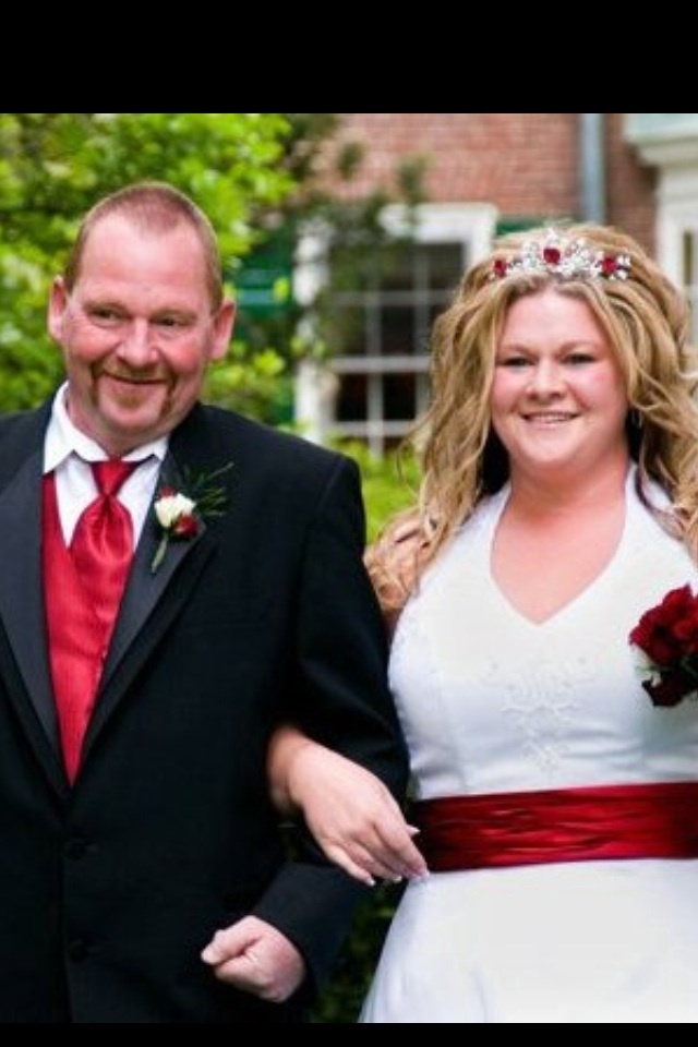 William Donnell escorts his daughter Amanda Brogan at her wedding May 15, 2010, in Rochester, N.H.