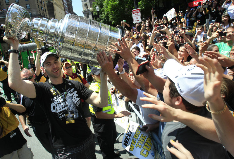 Zdeno Chara left the parade to bring the Stanley Cup to the fans, and a lucky few got the chance to touch it just three days after Boston beat Vancouver in seven games.