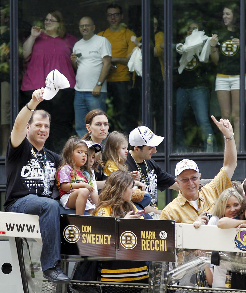 Mark Recchi, left, the oldest player in the NHL this season at age 43, took part in the celebration along with his family. Recchi is retiring after winning the Stanley Cup for the third time in his career.