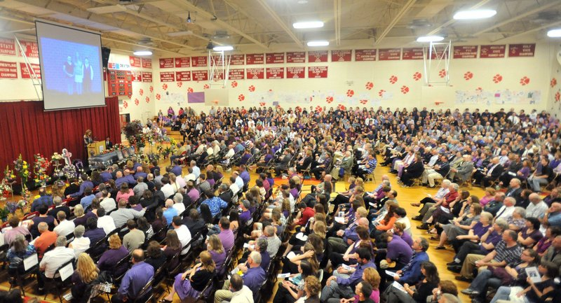 Nearly 1,000 people fill the gymnasium of Dexter Regional High School to remember Amy Lake and her children, Coty and Monica, during a funeral service Saturday. Lake graduated as valedictorian in the same gym.