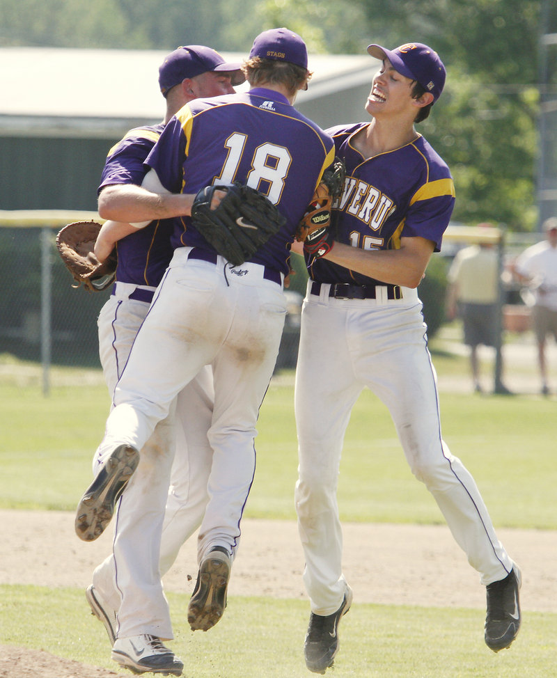Harry Ridge, 18, is joined by Louie DiStasio, right, and Joey Royer after the final out.