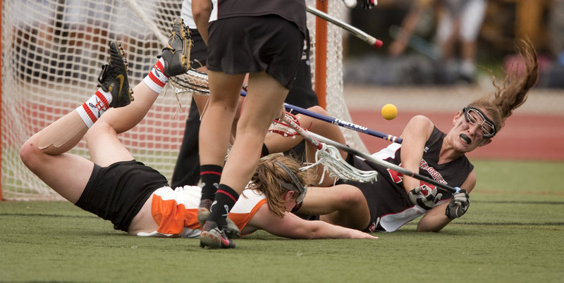 Corrine O'Connor, left, of Brunswick and Maiti Kent of Scarborough fall to the turf while battling for the ball during Scarborough's 13-11 win in the Class A girls' lacrosse final.