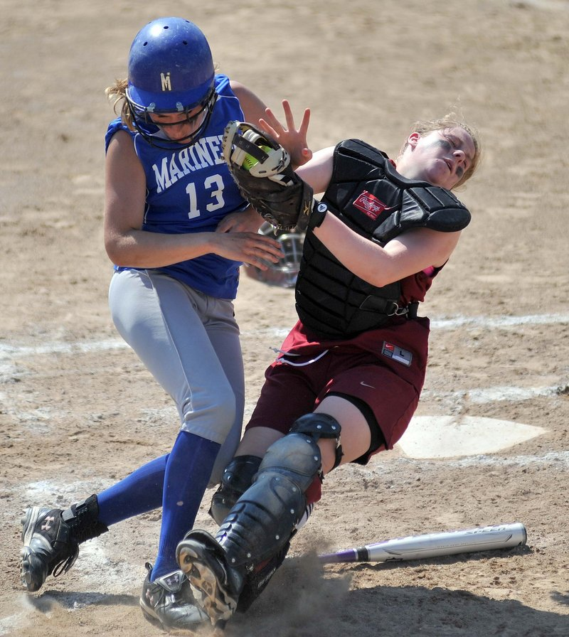 Richmond catcher Lindsy Hoopingarner, right, holds onto the ball as she collides with Deer Isle-Stonington's Chelsea Brown during the Class D state championship game Saturday. The Mariners won the game, 7-2.