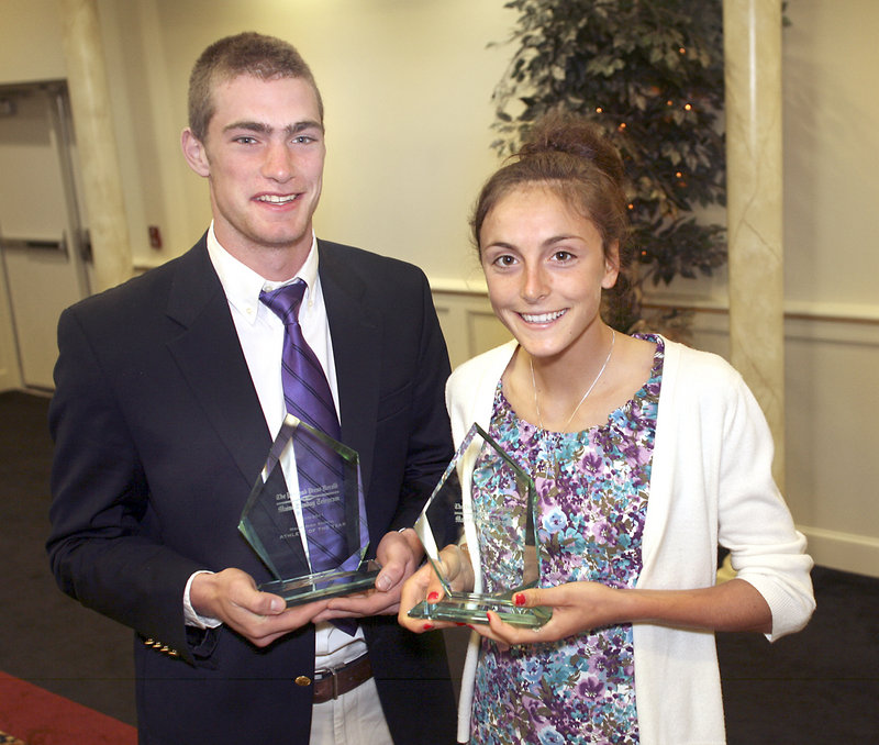 Athletes of the Year Peter Gwilym of Cheverus and Mia Rapolla of Gorham high schools display their awards in Portland on Sunday.