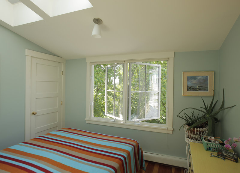 Windows and skylights let in lots of light and air in an upstairs bedroom.