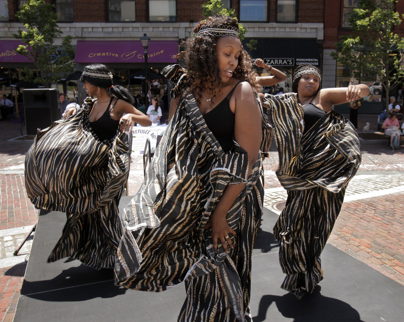 From left, Florence Namuhoranye, Marie Josee Musabyemaiya and Yvonne Karuta, dancers with Umoco Group, a Rwandan cultural group based in Portland, perform in Monument Square in Portland on Monday as part of a celebration marking World Refugee Day, which was started in 2001 by the United Nations High Commissioner for Refugees. In addition to the noon celebration, there was free food from Stareast Cafe and a film at Portland Public Library in the evening.