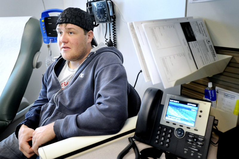 Peter Bernaiche, who was injured in Afghanistan and recently discharged from the Marines, waits to see one of the clinic's doctors. Bernaiche, who lives just minutes away in South Portland, used to drive several hours for his appointments.
