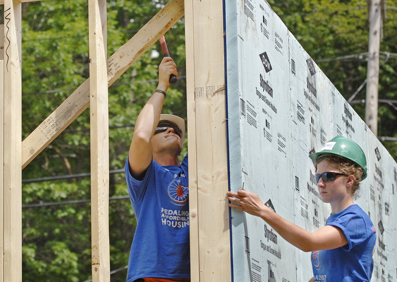 Kate Weigel of Brewer and Zach Schmidt of Pittsburgh work on a wall.