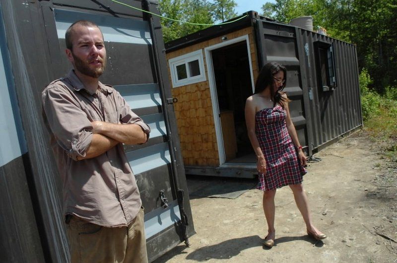 Trevor Seip and Jennifer Sansosti stand outside their shipping container home in Ellsworth. The couple have transformed two 20-foot-long containers – which they bought on the auction website eBay – into their home.