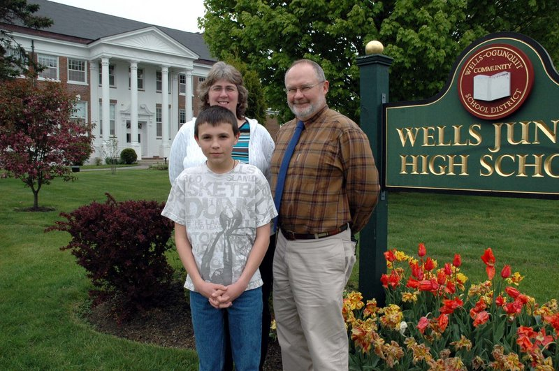 Wells Junior High School eighth-grader Nathan Ouellette poses with the school's gifted and talented teacher, Dawn Valente, and Principal Chris Chessie. Ouellette won a $1,000 scholarship for his participation in a Raytheon-sponsored math advocacy contest.