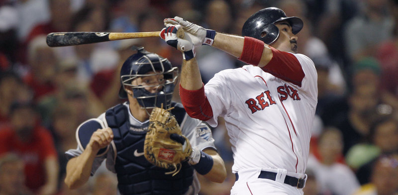 Adrian Gonzalez of the Boston Red Sox cracks an RBI double in the seventh inning Monday night, breaking a 3-3 tie and igniting a 10-run inning that helped produce a 14-5 victory against his former team, the San Diego Padres. The San Diego catcher is Nick Hundley.