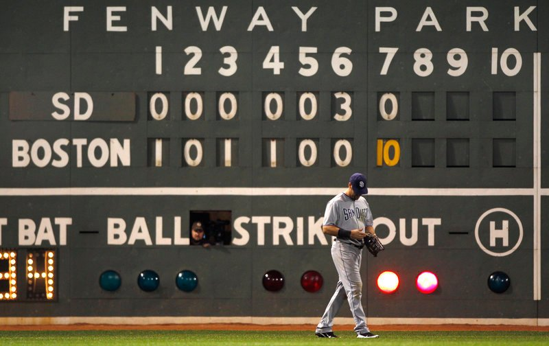 The scoreboard operator enjoys the Fenway Park view during the 10-run inning. San Diego left fielder Ryan Ludwick? Not so much. The Red Sox have won 14 of their last 16 games.