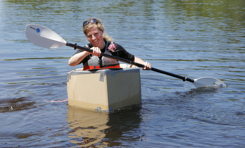 Shannon Bryan, who does not have a degree in naval architecture, test-drives a cardboard boat design.